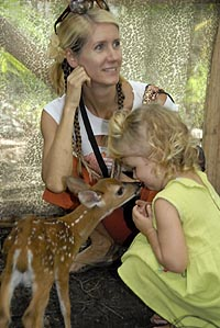 Serafina being kissed by 'Bambi' at Rainsong Wildlife Sanctuary